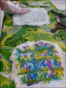 Step 3 - comb through dyes and place pre-washed fabric on shaving cream design.   Pat gently.