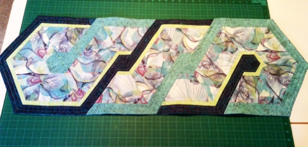 Mary's Triangle Frenzy table runner