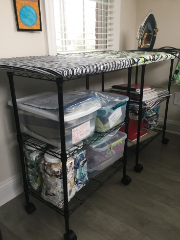 ironing board with shelves